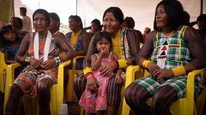 Photo of indigenous women sitting in a waiting room, Brazil.